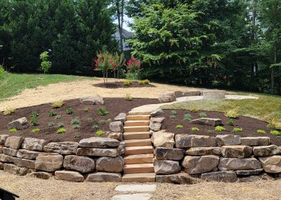 flagstone retaining wall with stone steps in Knoxville yard