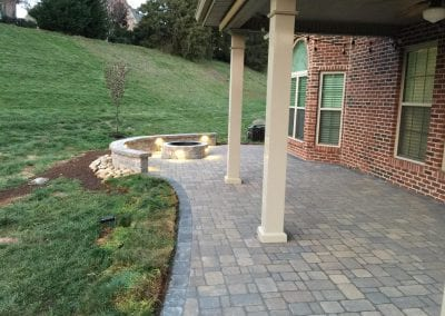 brick patio with outdoor fireplace