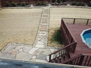 flagstone walkway and stairs leading to backyard pool