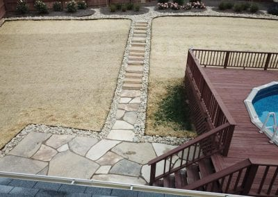 flagstone walkway and stairs leading to backyard pool