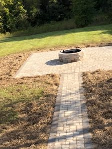 outdoor walkway and fireplace in knoxville backyard
