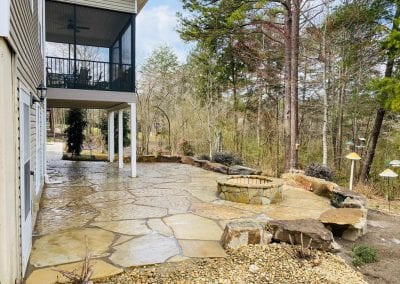 flagstone patio and outdoor fireplace in knoxville backyard