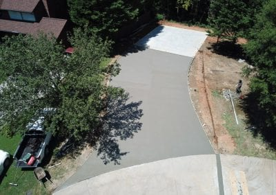 aerial view of paved concrete driveway under construction