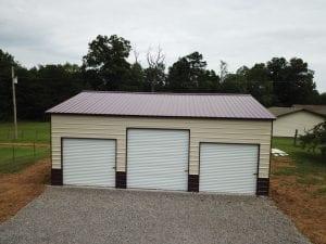 three door garage and gravel driveway
