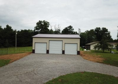 three door garage and gravel driveway