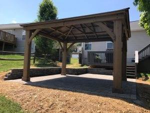stone patio with wood pergola