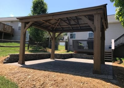 stone patio with wood pergola