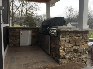 backyard patio stone counter with grill and sink
